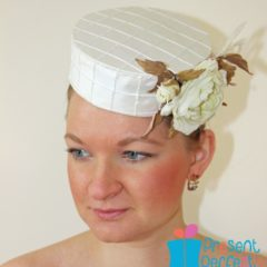 A pillbox hat with silk roses