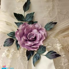Accentuate your bridal sash with a silk rose