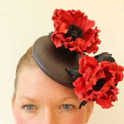 Leather hat with poppies