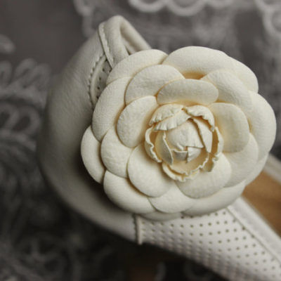 white flower shoe clips