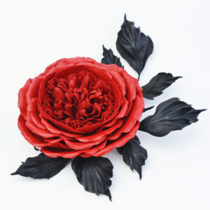 red leather rose brooch