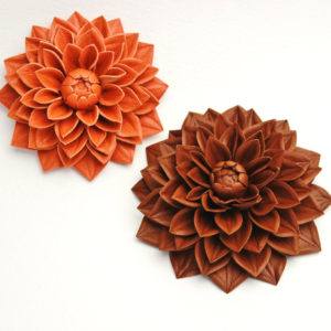 orange and brown leather flower brooches
