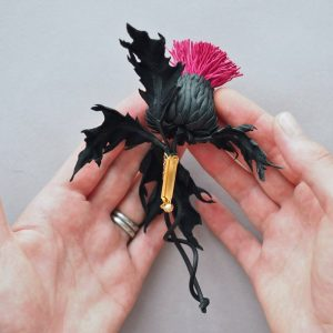 leather thistle brooch