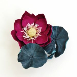 Leather lotus brooch