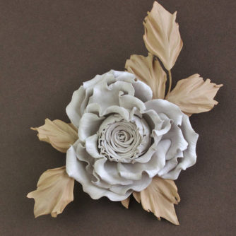 white and beige leather rose