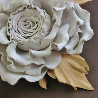 white and beige rose detail