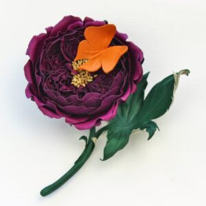 Leather English rose corsage with a butterfly