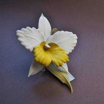 leather orchid brooch