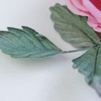 linen English rose brooch detail