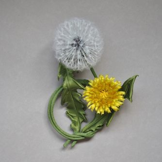 silk dandelion clock with a flower brooch