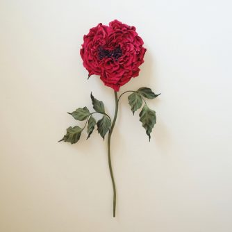 heart shaped red leather rose
