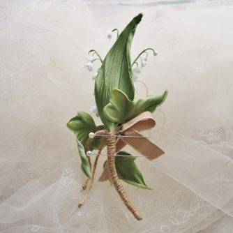 lily of the valley buttonhole back