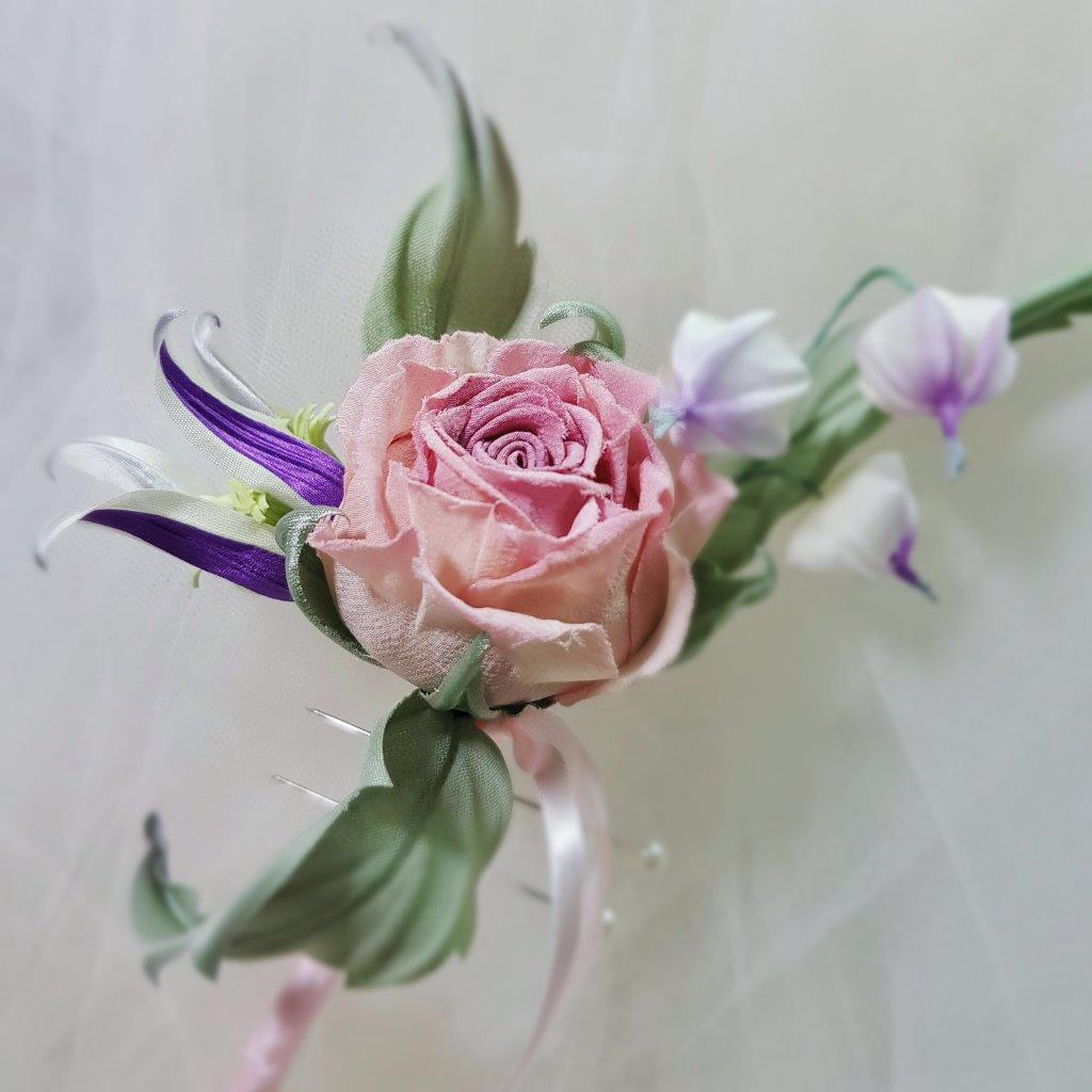 silk clematis and rose buttonhole