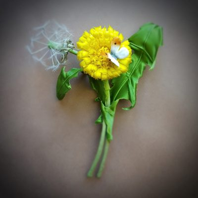 silk dandelion flower and clock corsage