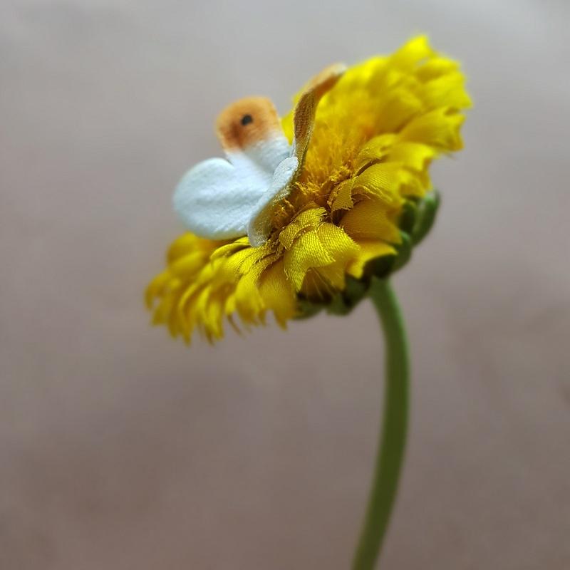 silk dandelion flower and clock corsage detail